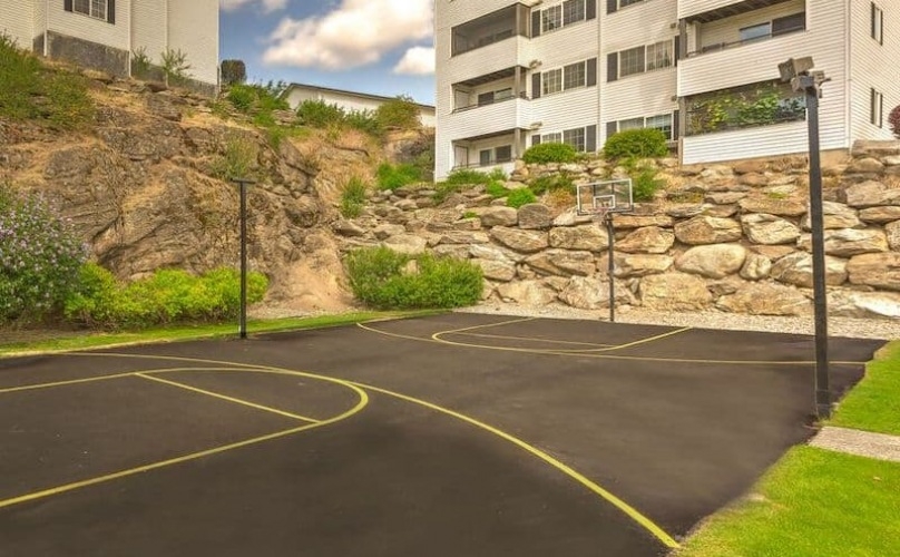 spacious basketball court near property buildings